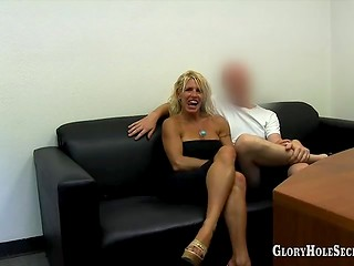 Busty blonde cougar tastes a lot of dicks through the gloryholes and swallows fresh jizz