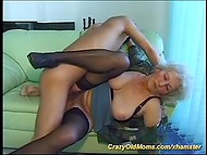 Big-titted granny trying to please her young friend by swallowing his pecker