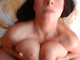 Hot brunette lady uses her huge natural boobs to masturbate her boyfriend's dick