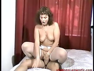 Vintage scene with handsome man and adorable MILF in sexy white stockings and pierced clit