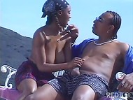 Black-skinned couple organized wonderful dirty scene outdoors taking a walk in mountains