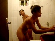 Young babes shake their naked asses in the bathroom after the relaxing shower