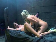Two stunning lesbian babes passionately do naughty things in the dark room