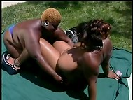 Black-skinned matures with huge forms pleasing each other somewhere outside