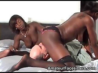 White balding guy gives wonderful cunnilingus to black-skinned bitches in sexy stockings