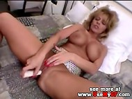 Mature dame stimulates her cunt with a sex toy before participating in spectacular sex