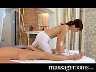 Young seductive masseuse works gently and carefully with her client's cock