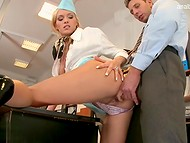 Marvelous blonde stewardess in sexy uniform remains alone with her boss in the office