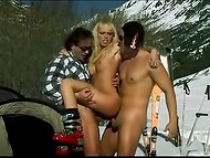 Rampant blonde skier girl with yummy boobs warmed up her boyfriends near the tent