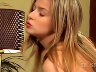 Young blonde coquette and her photographer having fantastic sex on the sofa 8