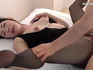 Lustful Asian buddy has ripped stockings of the appetizing girl with charming breasts and entered in cunt like a king