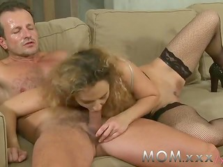 Busty MILF in amazing stockings gets penetrated wildly by handsome pornactor