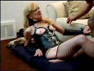 Blonde bitch in leather suit and with a chain on her nipples allows black guy to cum in her pussy  9