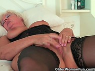 Horny granny in black stockings masturbates all day long without hesitations