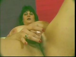 Dark-haired mature with huge natural breasts stimulated her vagina using the red dildo in the solo scene