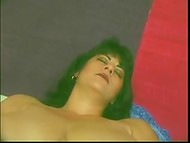 Dark-haired mature with huge natural breasts stimulated her vagina using the red dildo in the solo scene 7