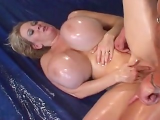 Oiled blonde Kayla Kleevage uses gigantic boobies to make her boyfriend happy
