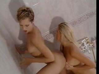 Two horny lesbian girls taking bath together