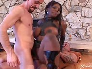 Black-skinned lady surely likes, when two wieners are getting deep inside of her holes 7