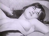 Attractive brunette chick demonstrated her big natural breasts in the black and white old-fashioned scene 11