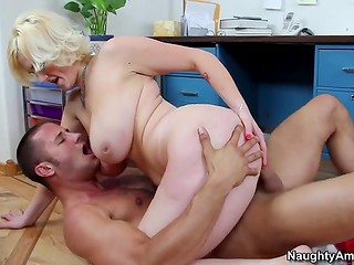 Busty blonde MILF with delicious butt rides her new sex partner's cock at the work place