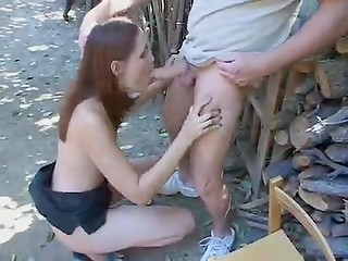 Teen girl sucks older man's cock outdoors till he cums in her eye