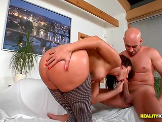 Charming lady in sexy pantyhose presented bald man a blowjob while he was fingering her snatch