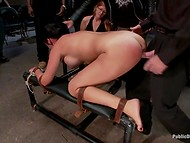 Busty brunette MILF got her pussy spread and fucked by a lot of stranger in the BDSM dungeon