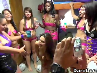 A crowd of students in frank dresses plays lecherous games in the dorm room