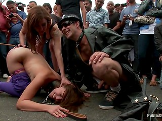 Big-tittied brunette was publicly humiliated and spanked in front of everyone on the street