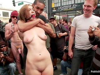 Charming young girl was undressed and disgraced in front of strange people in the street