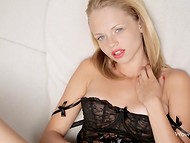 Petite fashionable blonde in black lingerie fingering her shaved vagina in front of the camera  10