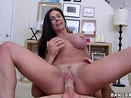 Horny brunette MILF passionately rides her mysterious lover's fat dong on the floor