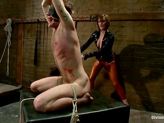 Wicked woman in latex costume punishes her weak husband in the CFNM video