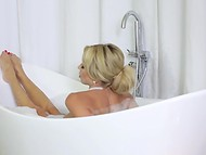 Intriguing blonde MILF undresses without any hurry and washes her sexy body in the bath 11