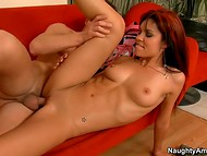 Sensual sex scene with a adorable brunette on a red sofa in the student hostel