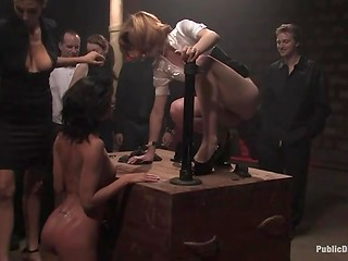 One frolicsome beauty is tied by a group of people who fuck all her holes