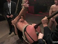 Girl was tied upside down to the ceiling and orally fucked her in the BDSM scene