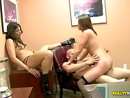 An enterprising boss fucked two excited secretaries in his office on the table