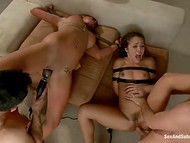 Naughty girls was tied to the bed and fucked by two muscular buddies