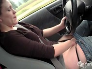 Mischievous lady has a great time fingering herself while driving the car