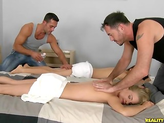 Clever masseur seduced two young horny chicks and they give him a high-class blowjob at once