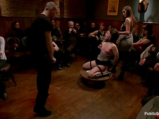 Brave girl agreed to become a BDSM toy for crazy crowd of sex hungry men