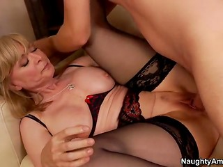Busty experienced woman allows her younger sex partner to penetrate her sweet vagina