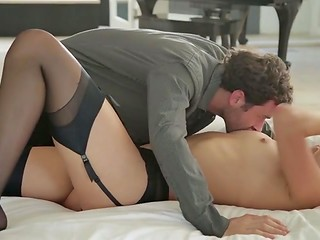 Sweet couple makes love in the missionary position after gentle oral foreplay