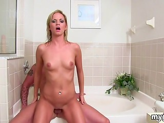 Young blonde babe received an abundant shower of sperm after pounding in the bathtub