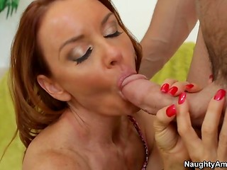 Red-haired MILF with big boobs bends for the huge dick of the son's neighbor