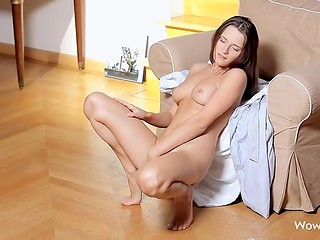 Young model with blue eyes and big natural titties demonstrates her wonderful body