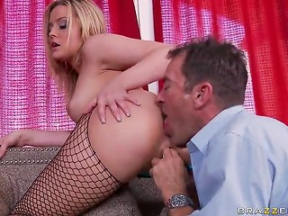 Exited bombshell in fishnet stockings happily having oral fun with muscular man
