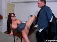 Brunette minx with huge tits pleasures co-worker with an alluring cock-sucking